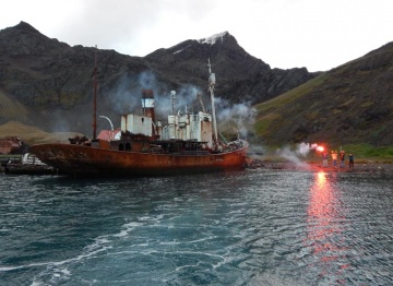 The locals let off flares to wave goodbye as Sheri heads out the ship that will take her north