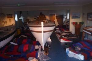 The unexpected visitors sleeping soundly the next morning around our replica of Shackleton's lifeboat James Caird. Image by Andrew Bishop