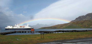 NG Explorer was one of the last ships through for the season. A vivid rainbow connected the ship to the cemetery where the passengers were landing