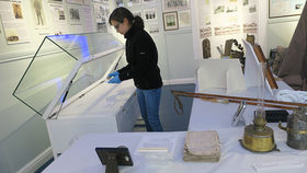 Curator Charlotte cleaning the artefacts in the Shackleton case