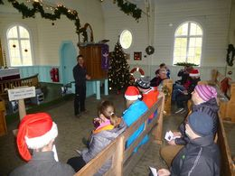 Simon officiates at the locals' Christmas service in the Church