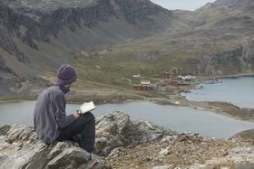 Theo Crutchley-Mack sketching the whaling station from Gull Lake