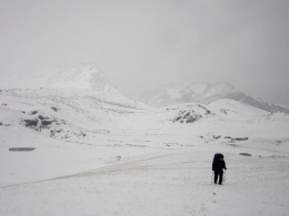Trudging over the pass in snow.