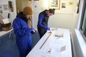 Laura and Dani carefully clean some of the artefacts relating to Sir Ernest Shackleton