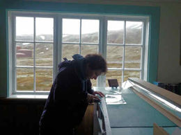 Hannah busy measuring the protective film for the church library windows