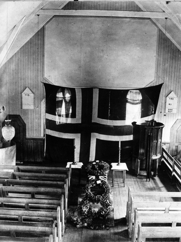 Wreaths on the coffin in the church Image courtesy of E.B. Binnie