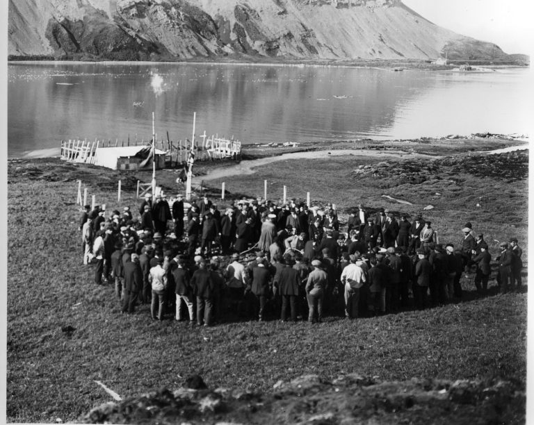 The burial at Grytviken cemetery overlooking King Edward Cove Image courtesy of E.B. Binnie
