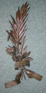 Metal funeral wreath in the style of a palm leaf inscribed in French with the name Sir Ernest Shackleton and '5 Janvier 1922, La Ligue Maritime et Coloniale Française, Section D'Argentine' South Georgia Museum: 1997.1.276
