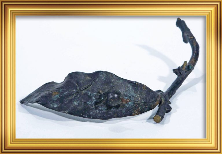 Bronze leaf and twig. A part of the memorial wreath on Shackleton's grave