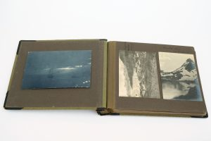 An album of photographs relating to the Quest Expedition collected by the Rowett family. The whaling stations at Gytviken and Prince Olav Harbour can be seen in the photographs on the right hand page. The album is still owned by the family. On loan from Jan Chojecki