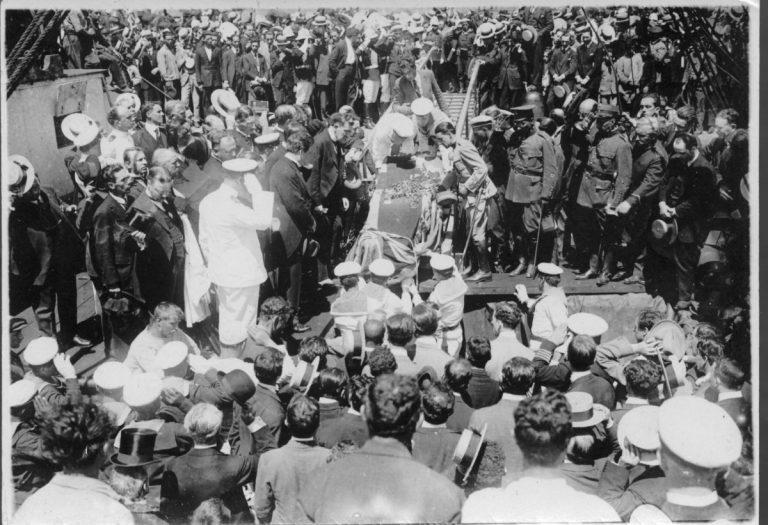 The coffin being taken aboard Woodville in Montevideo