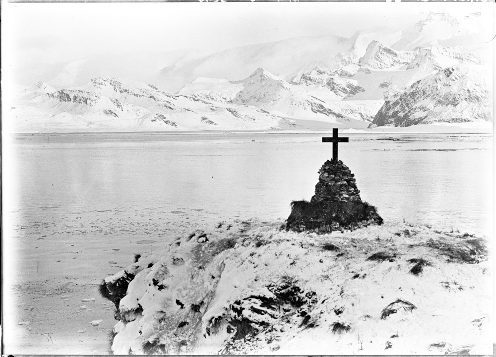 The cairn and memorial cross stand on Hope Point overlooking King Edward Cove Image courtesy of State Library of New South Wales