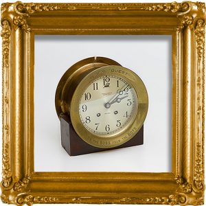 A brass clock, given to Shackleton at the outset of the Quest Expedition and sat in his cabin. It is engraved 'To the Boss from the Boys'. On loan from the Scott Polar Research Institute. Pop-up link to SPRI Catalogue